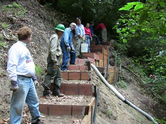 Building a retaining wall at the Creek Trail project in Memorial Park